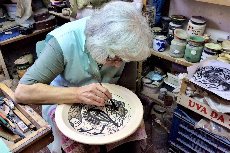#5 Guido_s wife Chiara hand painting an intricate design